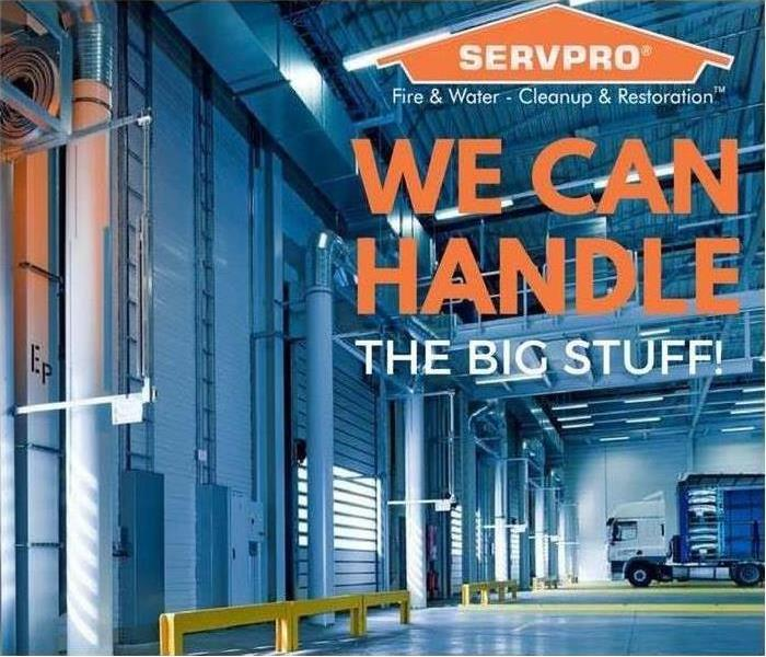 "Large warehouse with wording that reads ""We can handle the big stuff"""