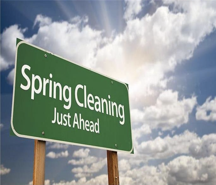 "a road sign that reads ""spring cleaning ahead"""