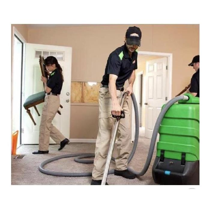A SERVPRO team performing a carpet cleaning